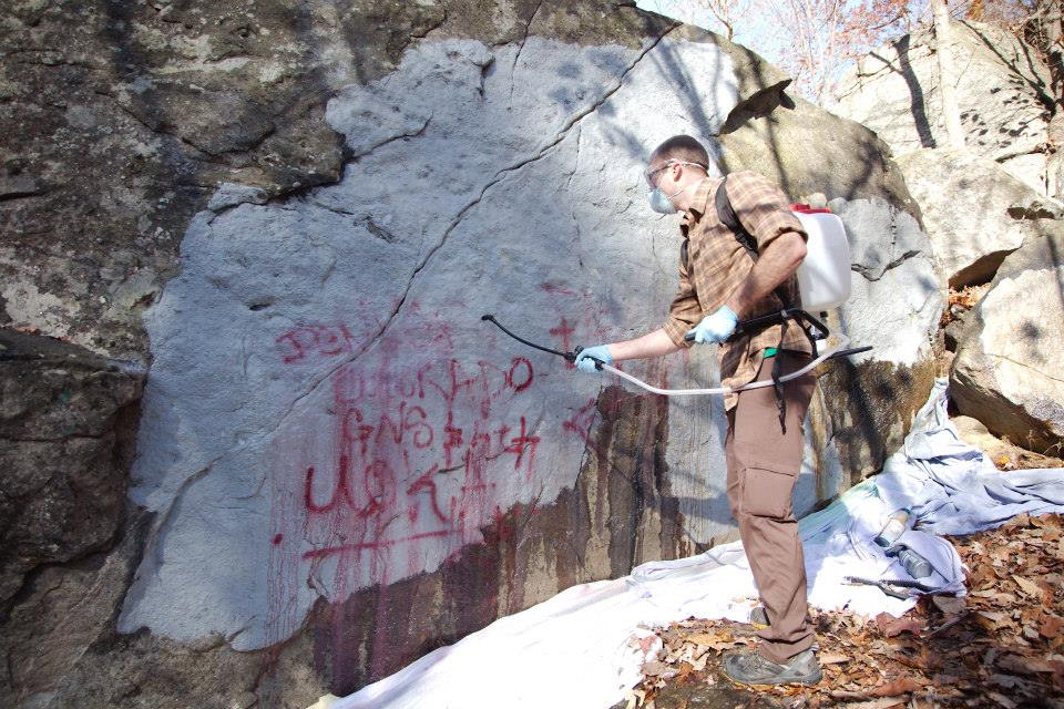 Removing graffiti at Northwest Branch: November 2013