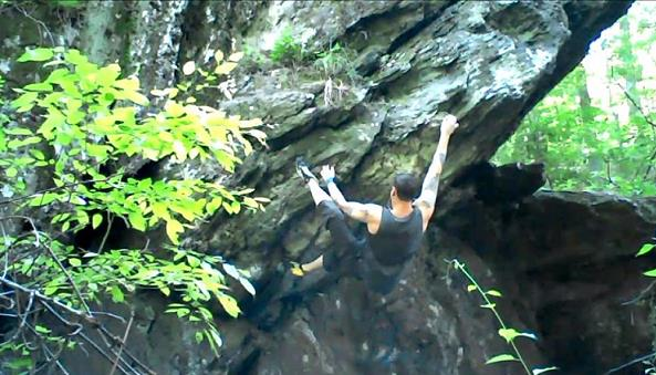 A climber on Crystal Crimps V4 at Morgan Run NEA